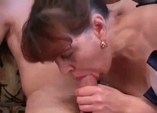 Redhead mom with red lips sucks her son's hard dick