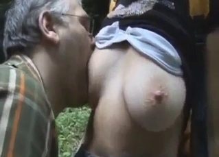 Daddy licks his daughter's hard nipples in the forest
