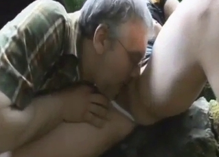 Daddy licks his daughter's cunt in the forest