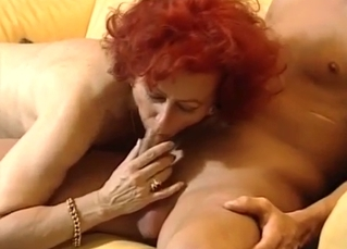 Redhead mom gives a very good and deep blowjob