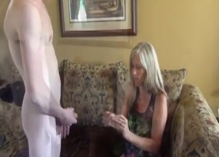 Real son licks his mother's pussy on the knees