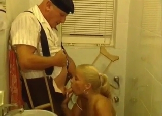 Golden blonde blows her uncle's dick in the toilet
